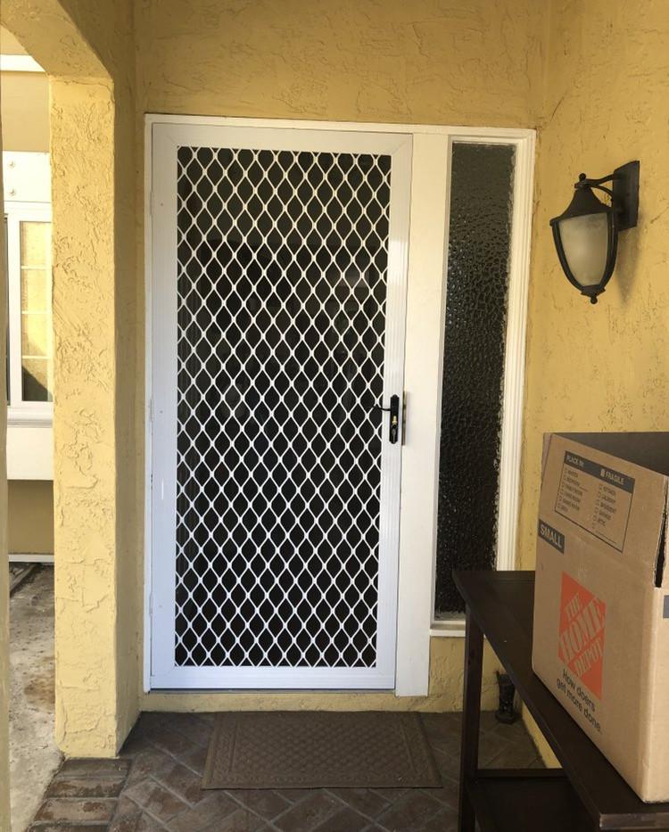 Beautiful white Sentry security door installation.