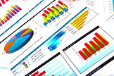 Financial paper charts and graphs on the