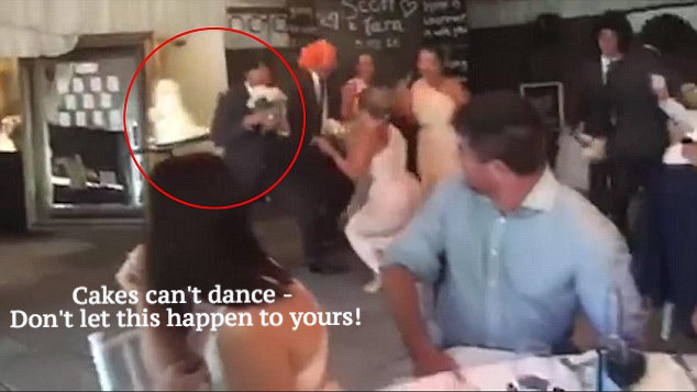 Dancing Guest Knocks over Wedding Cake