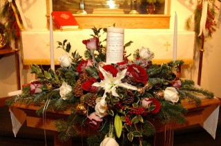 Christmas Flowers around Unity Candle by Deihl's Flowers