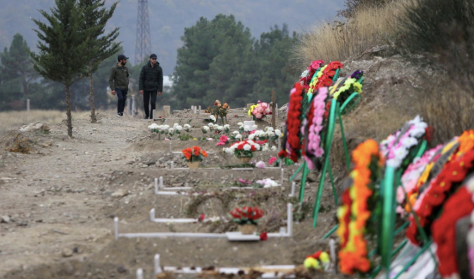 Graves of soldiers and civilians killed during the past six weeks of heavy fighting over Nagorno-Karabakh [Vahram Baghdasaryan/Photolure via Reuters]