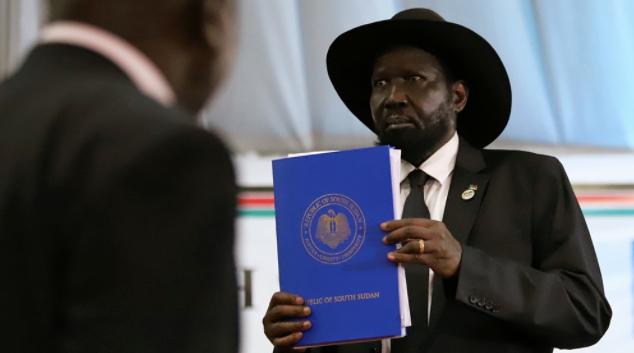South Sudan's President Salva Kiir Mayardit holds a copy of a signed peace agreement [Samir Bol/Reuters]- Al Jazeera