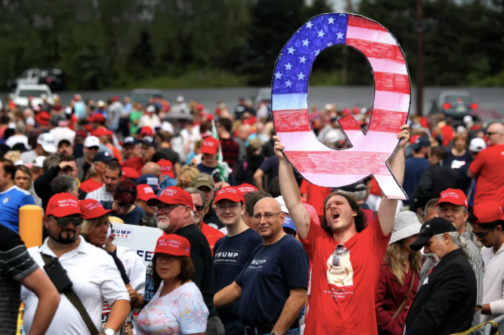 A QAnon supporter waiting to see Donald Trump at a rally in Pennsylvania. Rick Loomis/Getty Images