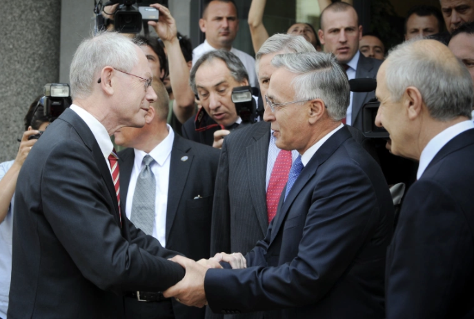 Jakup Krasniqi, seen here meeting then European Council President Herman Van Rompuy in 2010, is a veteran Kosovo politician and one-time the speaker of parliament [File: Armend Nimani/AFP]