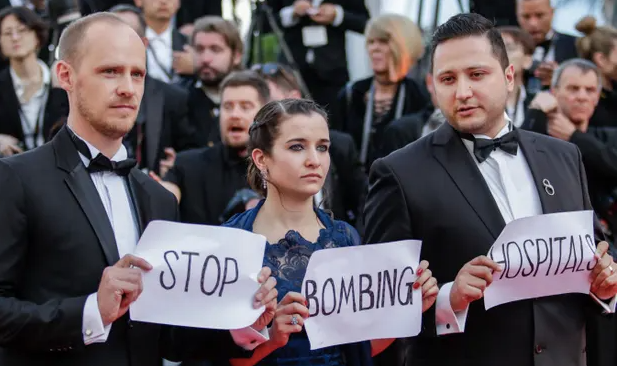 Co-director Edward Watts, Waad al-Kateab and her husband Hamza take their message to the Cannes film festival earlier this year. Photograph: Alamy