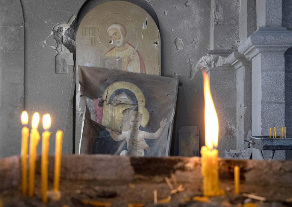 SHUSHA, NAGORNO-KARABAKH - OCTOBER 24, 2020: Candles and religious icons at the Ghazanchetsots ... [+] STANISLAV KRASILNIKOV/TASS
