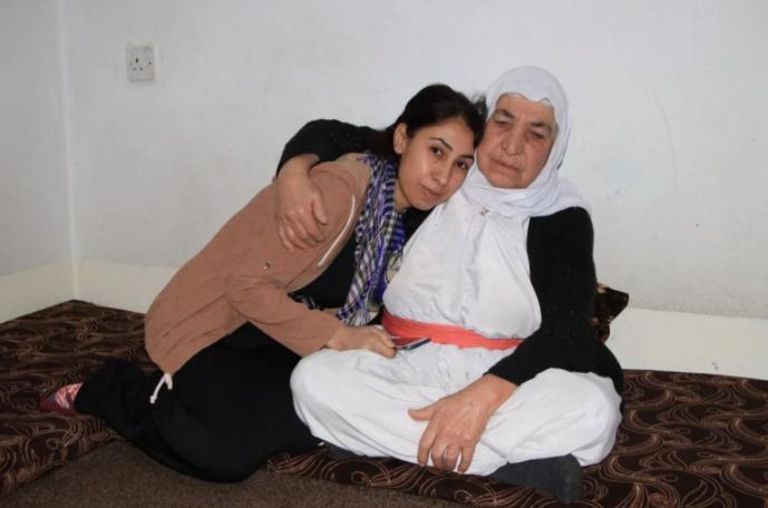 Layla with her mother [Salah Hassan Baban/Al Jazeera]