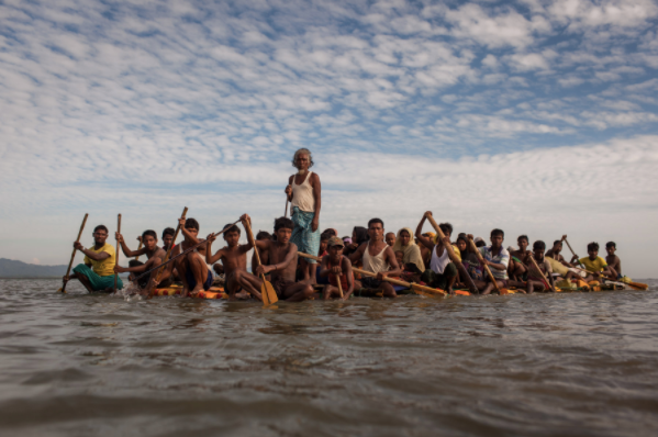 Rohingya refugees cross the Naf River on a makeshift raft made of bamboo and empty palm-oil cans—a five to seven-hour-long journey. Patrick Brown ©Panos/UNICEF 2018