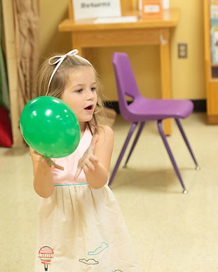 child having fun with balloon
