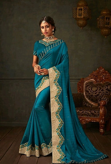 Comely Embroidered & Heavy Work Georgette Saree - Blue