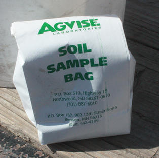 Bagging soil to send to AgVise for analysis