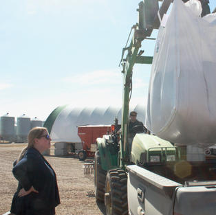 Elizabeth Karpinchick, Chair of MOA, oversees seed loading at Avondale Seeds