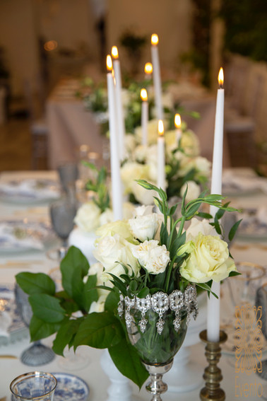 white flowers and candles.