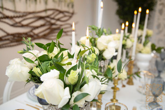 Green and white centerpiece design by Evento.