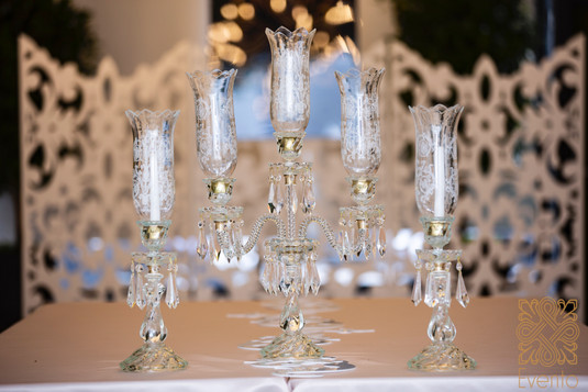 Laleh, Embellished Glass Candle holders which traditionally is used in Sofreh Aghd (Persian Cermony) and they come usually in different sizes from one branch to three or five branches which adds more texture and beauty to any Sofreh Aghd.