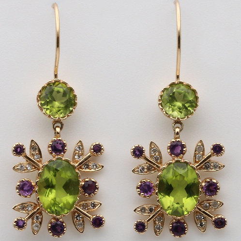Gold ear rings in suffragette colours