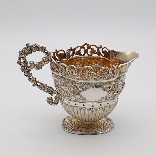Victorian silver gilt jug