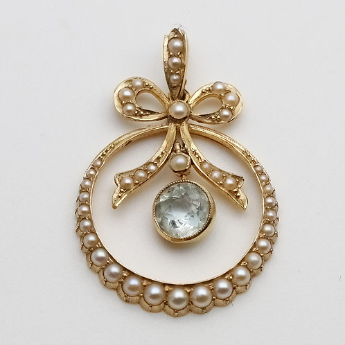 Early 20th century gold aquamarine and split pearl pendant