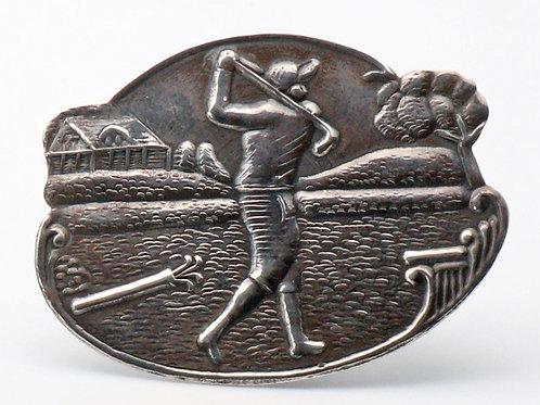 Silver golfer brooch