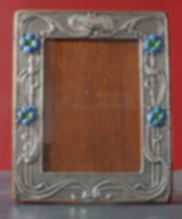 Matched pair of Art Nouveau silver photograph frames by William Neale