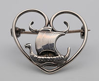 Carl Ove Frydensberg silver heart-shaped Brooch with inset Viking ship  £75