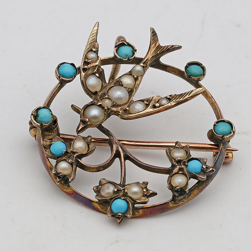 Edwardian circular brooch/pendant with swallow