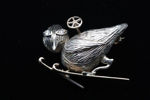 Novelty gold brooch of a bird on skis