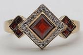 Diamond and garnet gold ring