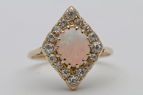 Edwardian 18ct gold ring set with an opal and diamonds