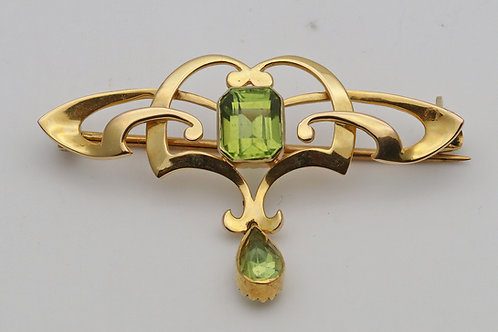 20th century gold and peridot brooch