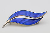 Aksel Holmsen brooch with bright blue guilloche enamel  sold for £50