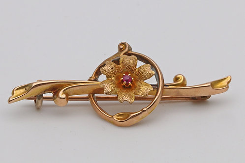 Art nouveau gold and ruby bar brooch