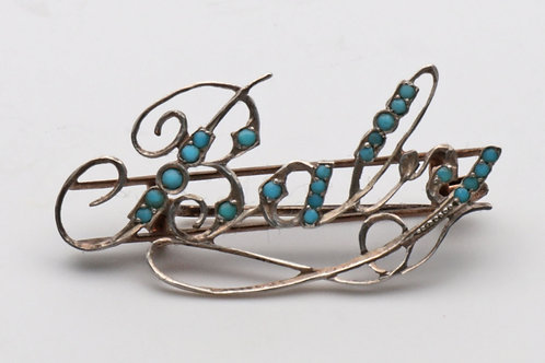 Baby brooch with turquoise stones
