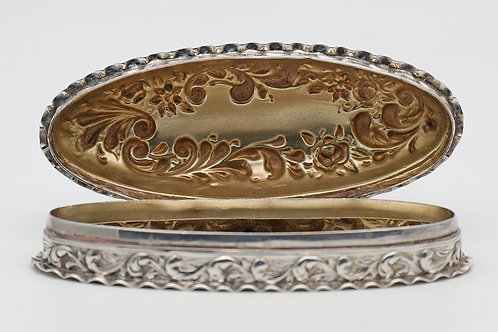 Edwardian oval silver box with crimped edges