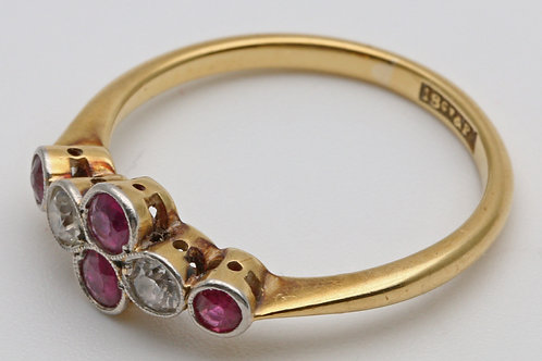 Gold ring with rubies and diamonds set in platinum