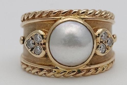 Gold split pearl and gem set ring