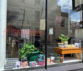 Photo of handmade bags in shop window