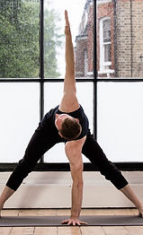 Image of a man performing a twisted triangle pose