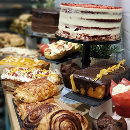 A photo of some delicious cakes and pastries.