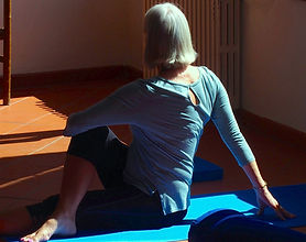 Image of woman performing a seated back twist