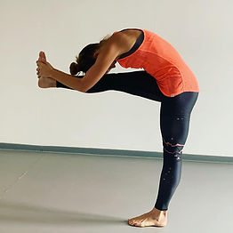 Image of woman performing a single standing leg pose