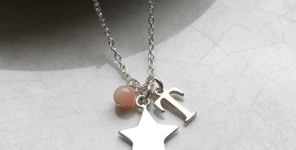 star necklace with initial and birthstone in sterling silver