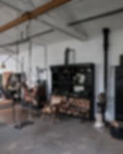 poele à bois atelier verrière industriel laion acier création luminaire fabrication