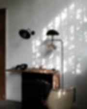 bent light sconce black patina handmade studio light