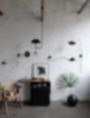 atelier création fabrication luminaire ligne graphique materiaux acier laiton
