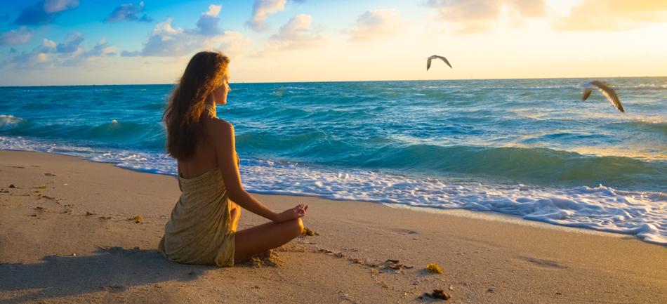 Girl Meditating on Beach.png