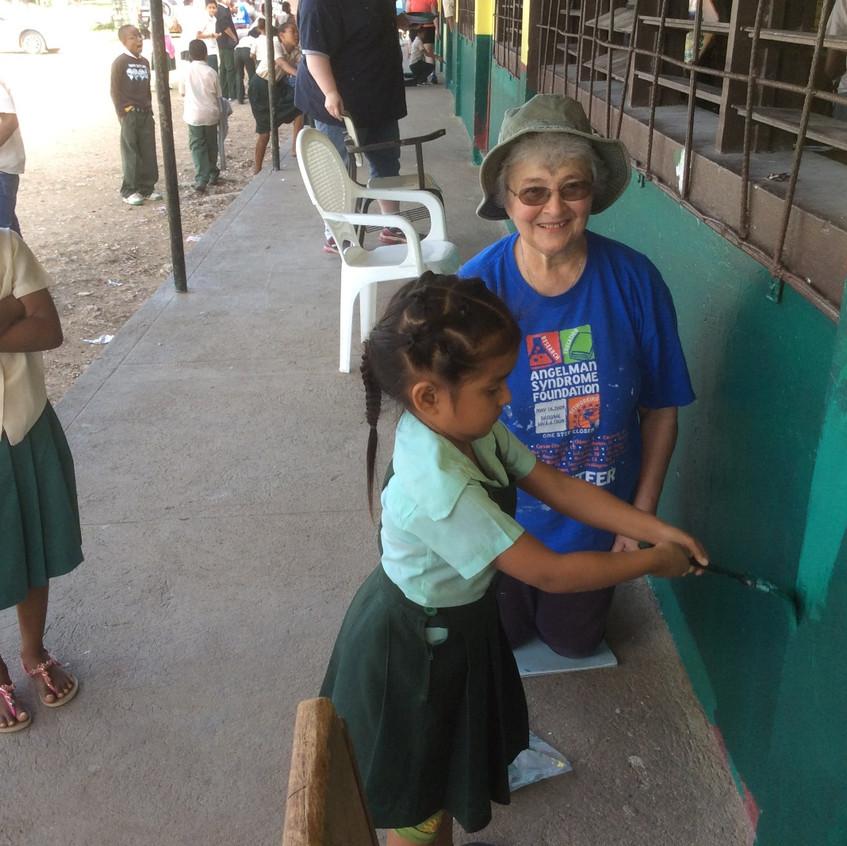 St. Jude School students help paint their school