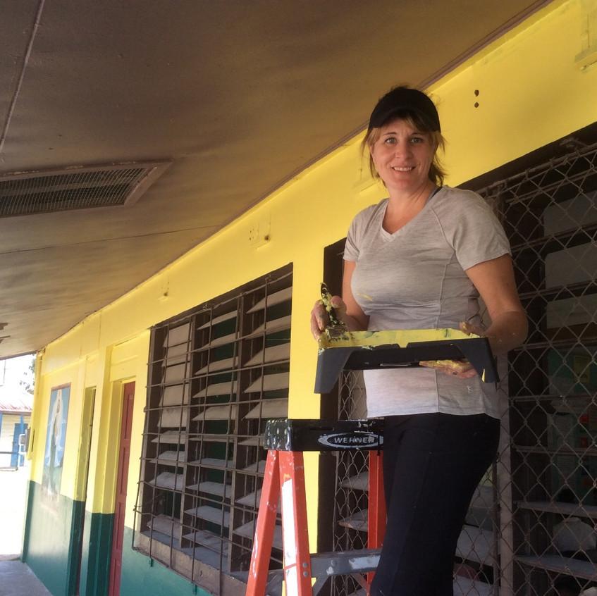 Mrs. McDonough helps paint St. Jude School