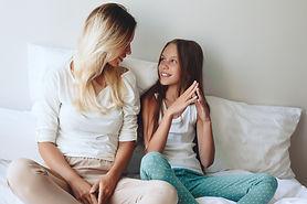 Mom with her tween daughter relaxing in