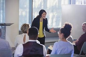 woman giving speech at keynote presentation
